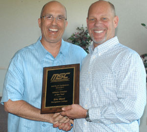 MSC Commissioner Steve Baker gives GC AD Eric Ward the Athletic Director of the Year Award as voted on by all MSC ADs.