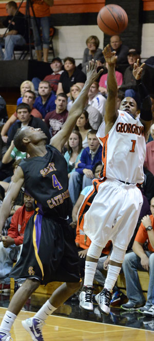 Eddie Gray hits a three over a St. Catharine defender. Photo by Richard Davis
