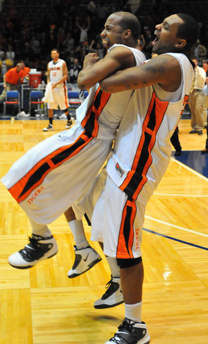 Eddie Gray and Rodney Haddix celebrate winning the MSC. Gray hit four free throws in the final minute to secure the win.