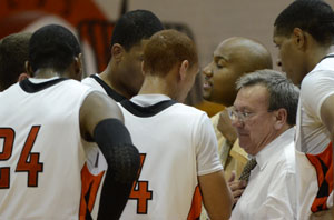 GC Coach Happy Osborne pulls his players in during a time out. Photo by Richard Davis