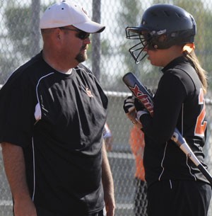 Coach Thomas Thornton discusses strategy with Katie Mann in a game this past season.