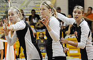 Alyssa Elmore, Cathy Frank, and Kelsey Luckett prepare for action