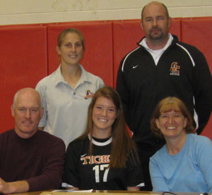 SCHS' Alicia Ducett recently signed to play soccer at GC. Also pictured, her parents Scott and Sonya and the GC coaches.