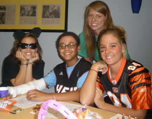 Taylor Henderson, left, Rachel Isaacs, and Taylor Fiest helped run a Halloween Party at a Children's Hospital in Louisville.