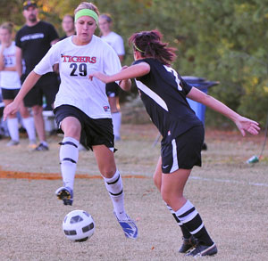 Alex Harbowy dribbles the ball against Pikeville in a recent game. Photo by Richard Davis.