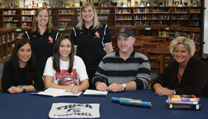 Angie Lawrence signs to play for Georgetown College women's basketball team.