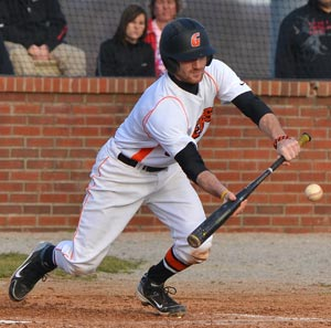 Chris Wood puts down a bunt during one of GC's two games Friday against Asbury. Photo by Richard Davis
