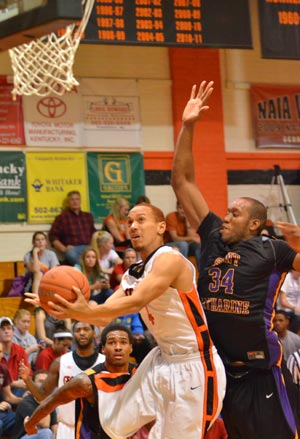 Johonne takes a contested shot earlier this season against SCC. Photo by Richard Davis