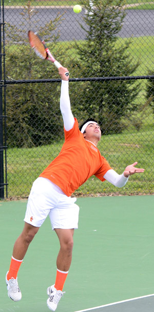 Benjamin Aspillaga serves during a tennis match earlier this year. Fans can help Tigers raise money clocking their serve.