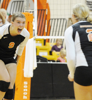 Kelsey Luckett and Rebekah Moore celebrate a point this past season during the Rumpke Invitational. Photo by Richard Davis