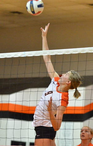 Kesley Luckett hits a kill earlier in the season. The senior tied a match-high 10 kills Monday. Photo by Richard Davis.