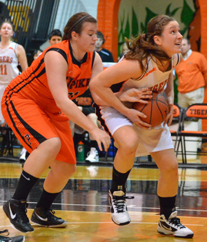 Gina Beining takes up a shot against Pikeville recently. Photo by Richard Davis