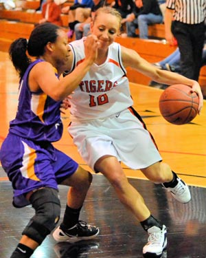 Jessica Waddle battles on the wing during a game with St. Catharine. Photo by Richard Davis