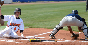 Mike Steinke scores the lone run for the Tigers against Texas Wesleyan in a 9-1 loss.