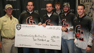Billy Perkins recently presented Georgetown College's fishing team with a check.