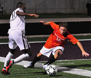 Matthew Murphy plays defense against CU Tigers Thursday. Photo by CU's Richard Robards.