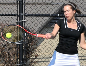 Haley Hart hits a return in a recent match. Monday she won in singles 6-0, 6-0. Photo by Richard Davis