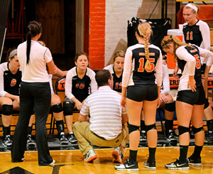 The Tigers huddle up during a match earlier this year. GC is 1-1 in pool-play in Sioux City, Iowa. Photo by Richard Davis