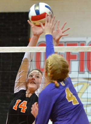Rachel Eubanks goes for a block in a match against Taylor this past year. Photo by Richard Davis