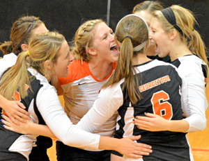 GC is 1-0 in pool-play. The Tigers celebrate a point on senior day earlier this season. Photo by Richard Davis