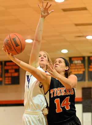 Devon Golden puts up a shot against TNU earlier this season. She had a double-double Tuesday. Photo by Richard Davis