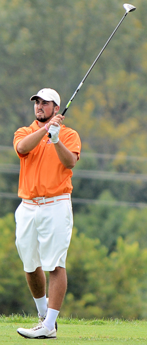 Morgan Reed watches his tee shot Monday. Photo by Richard Davis