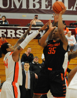 Deondre McWhorter goes up for a shot against UPike's Chris Cantino. Photo by Richard Robards