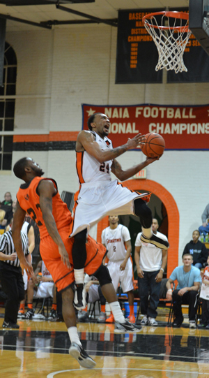 Dominique Hagans elevated for two points as GC knocked off the Bears. Photo by Richard Davis