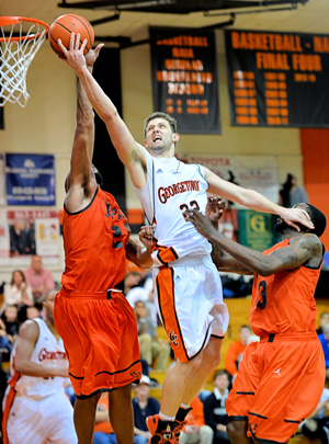 Russ Middleton slices between two UPike defenders. Photo by Richard Davis