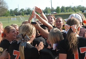 Tiger softball team lifted the MSC Tournament trophy after rallying for two wins Sunday.