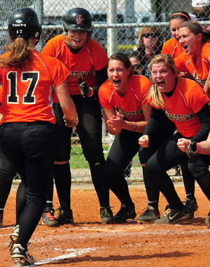 Tigers wait to celebrate with Sandy Young after her three-run homerun. Photo by Richard Robards