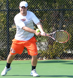 Ryne Least returns a shot at the Lackey Tennis Center. Photo by Richard Davis
