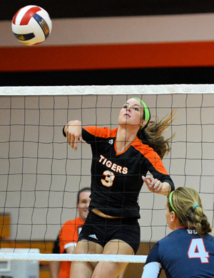 Caraline Maher takes a swing and tallies a kill. Photo by Richard Davis