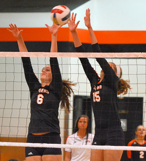 Allyson Weber and Ashlee Howe block a shot. Photo by Richard Davis