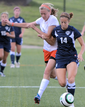 Bea Cameron battles an MVNU player for possession. The two teams have played two epic matches in the past two years. Photo by