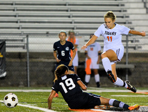 Jackie Powell hurdles a defender. Photo by Richard Davis.