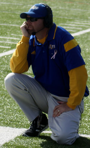 Michael Caba, '01 GC graduate, returns as offensive coordinator.