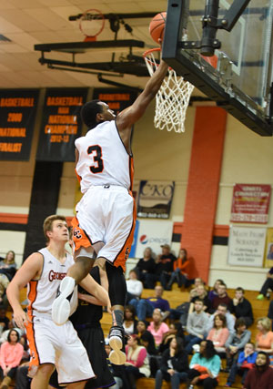 Darion Burns soars for two of his 20 points Saturday. Photo by RIchard Davis.