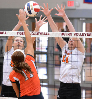 Jenny Howell and Corri Muha team up for a block in quarterfinal match Friday. Photo by Richard Robards