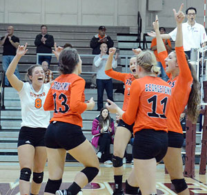 Tigers celebrate a point in a five-set win Saturday in the semifinals. Photo by Richard Robards