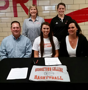 Leslie Fries, joined by Tim and Michelle Fries as well as coaches Andrea McCloskey and Kourtney Tyra signs with Georgetown.