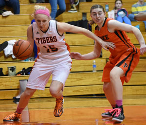 Jessica Foster drives around a Bear defender Monday. Photo by Richard Davis.