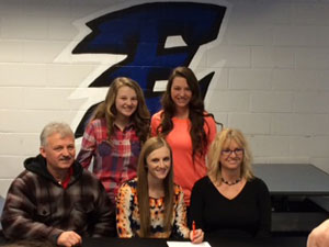 Kennedy Flynn signs with Georgetown College. Greg, Kennedy and Gina Flynn; Kiley and Kassidy Flynn.