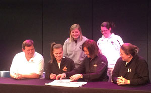 Lydia Graves signs with GC. Lydia, Cindy Graves and Jamie Richey; coaches Andrea McCloskey and Kourtney Tyra.