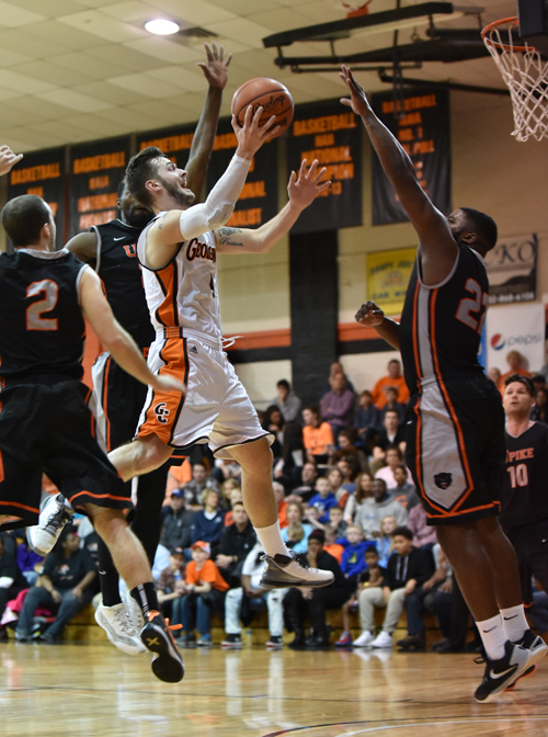 Noah Cottrill slices in for two of his game-high 26 points. Photo by Richard Davis