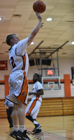 Trent Gilbert sinks one of his five threes off an assist from Tony Kimbro. Photo by Richard Davis