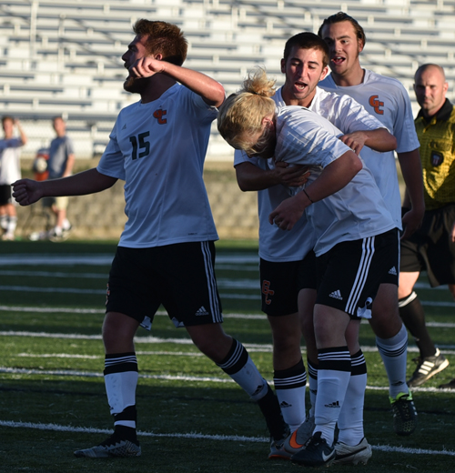 Tigers surround and celebrate with Trent Boyd with the winning goal Saturday. Photo by Richard Davis