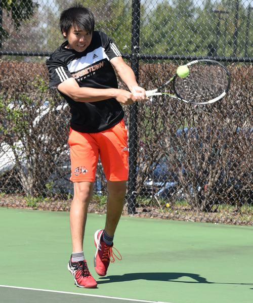 Ryo Takeda returns a shot in his singles' match. Photo by Richard Davis