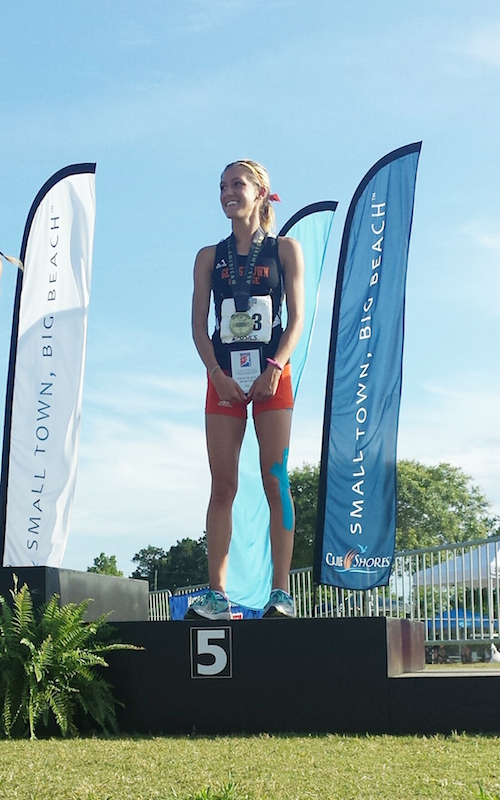 Tayler Godar finished fifth and earned NAIA All-American status in women's outdoor track and field.