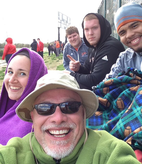 Tiger throwers and coach bundle up between competitions Saturday. Photo submitted